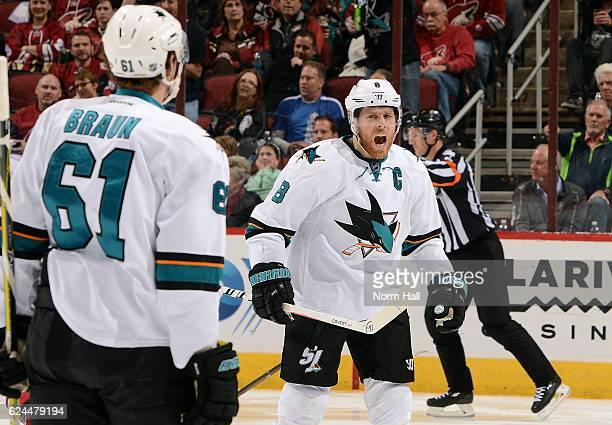 Joe Pavelski of the San Jose Sharks reacts toward teammate Justin Braun after Pavelski's third period goal the Arizona Coyotes at Gila River Arena on...