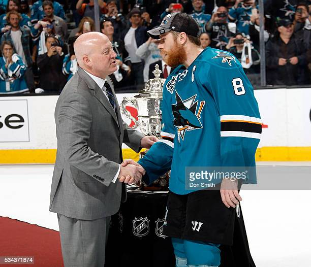 Joe Pavelski of the San Jose Sharks receives a handshake from NHL Deputy Commissioner Bill Daly and presented the Clarence S Campbell Bowl after the...