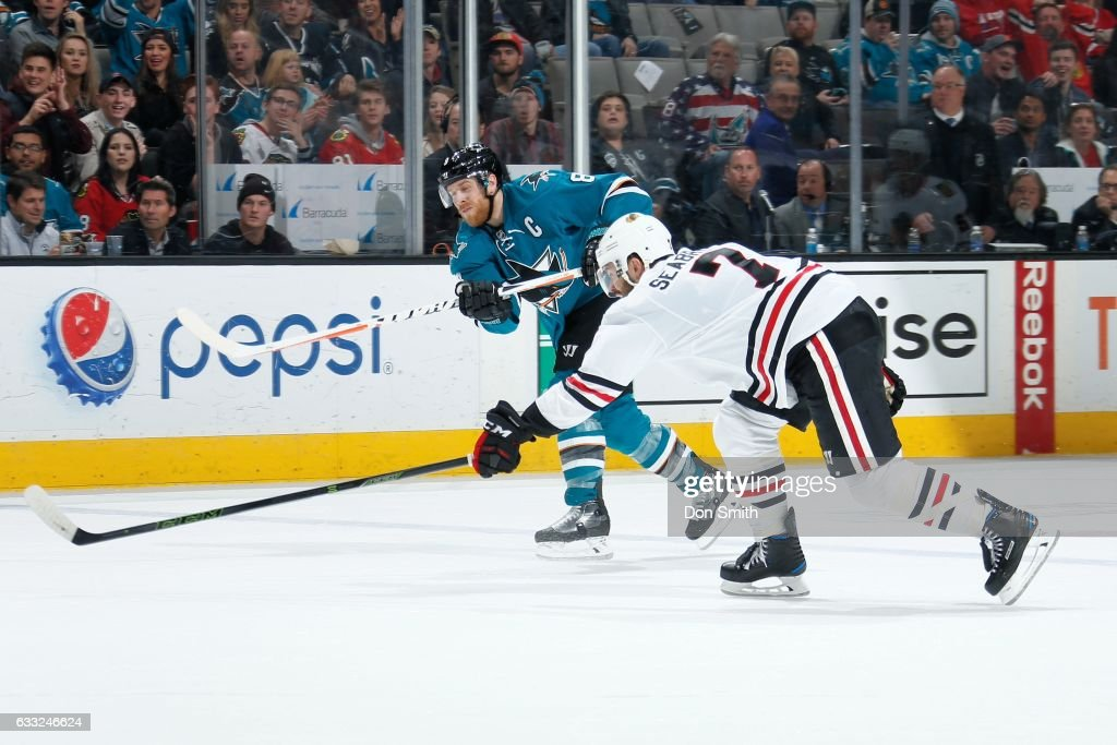 Joe Pavelski #8 of the San Jose Sharks scores a empty net goal during the third period as Brent Seabrook #7 of the Chicago Blackhawks tries to defend at SAP Center at San Jose on January 31, 2017 in San Jose, California.