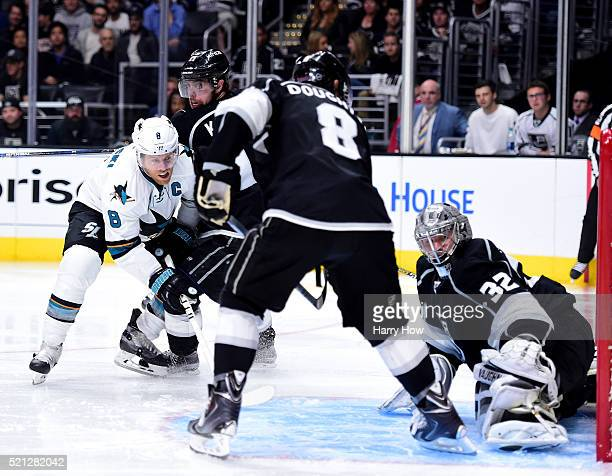Joe Pavelski of the San Jose Sharks scores a goal past Jonathan Quick to take a 43 lead between Anze Kopitar and Drew Doughty during the third period...