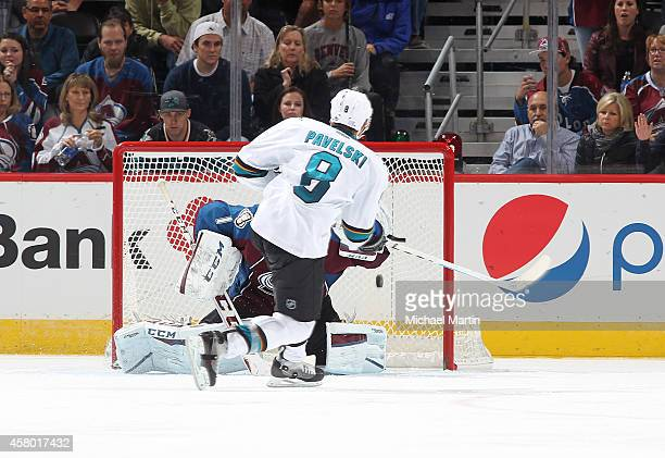 Joe Pavelski of the San Jose Sharks scores a shootout goal against goaltender Semyon Varlamov of the Colorado Avalanche at the Pepsi Center on...