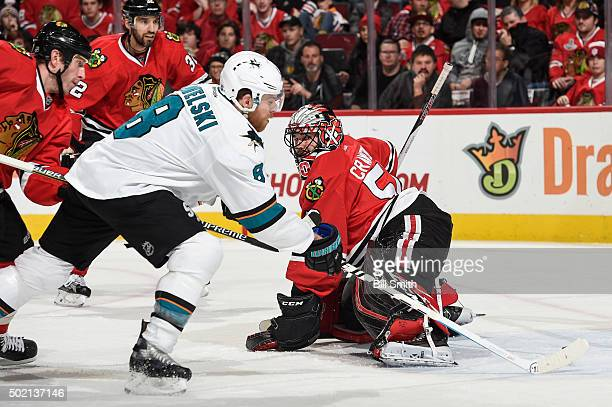Joe Pavelski of the San Jose Sharks scores on goalie Corey Crawford of the Chicago Blackhawks in the second period of the NHL game at the United...