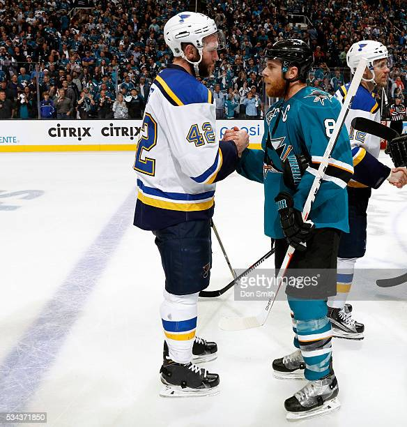 Joe Pavelski of the San Jose Sharks shakes hands with Davis Backes of the St Louis Blues in game six of the Western Conference Finals during the 2016...