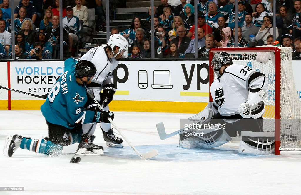 Joe Pavelski #8 of the San Jose Sharks shoots and scores against Jonathan Quick #32 of the Los Angeles Kings as Drew Doughty #8 of the Los Angeles Kings defends against the shot during the Western Conference First Round during the 2016 NHL Stanley Cup Playoffs at the SAP Center at San Jose on April 20, 2016 in San Jose, California.