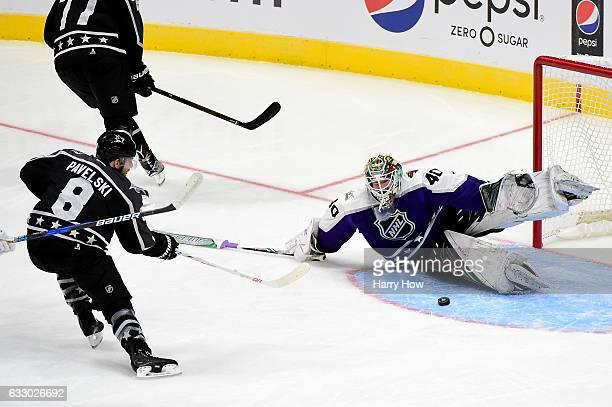 Joe Pavelski of the San Jose Sharks shoots the puck against Devan Dubnyk of the Minnesota Wild during the 2017 Honda NHL AllStar Game Semifinal at...