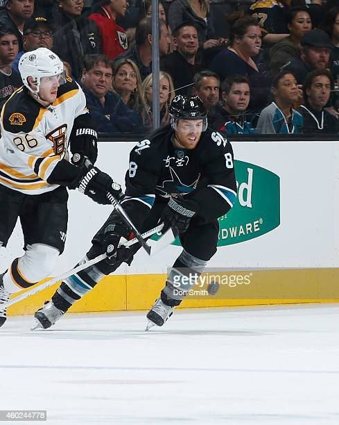 Joe Pavelski of the San Jose Sharks skates after the puck against the Boston Bruins during an NHL game on December 4, 2014 at SAP Center in San Jose,...