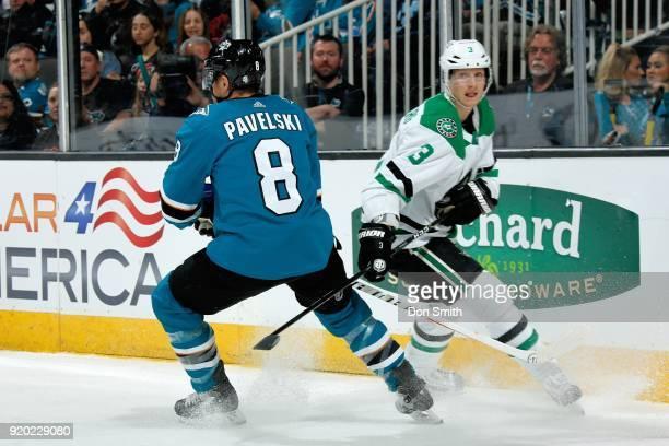 Joe Pavelski of the San Jose Sharks skates against John Klingberg of the Dallas Stars at SAP Center on February 18 2018 in San Jose California