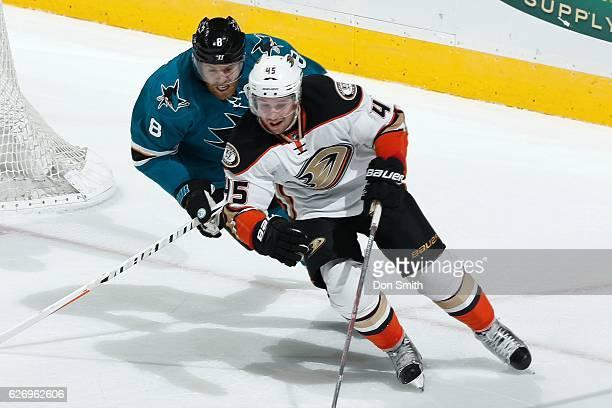 Joe Pavelski of the San Jose Sharks skates against Sami Vatanen of the Anaheim Ducks during a NHL game at SAP Center at San Jose on November 26, 2016...
