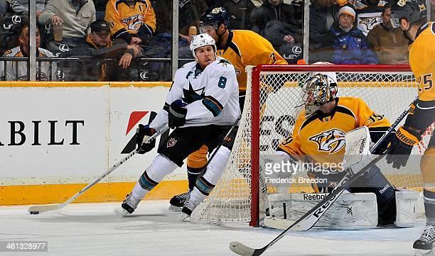 Joe Pavelski of the San Jose Sharks skates towards goalie Marek Mazanec of the Nashville Predators at Bridgestone Arena on January 7 2014 in...