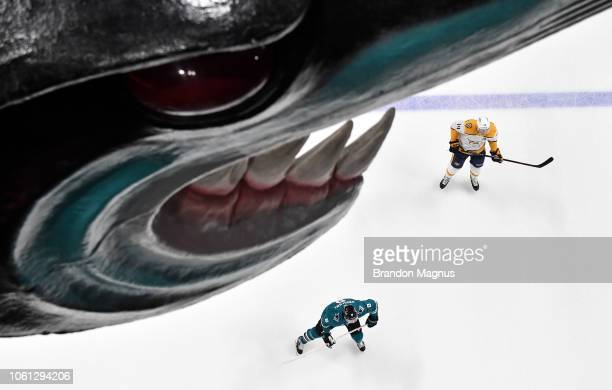 Joe Pavelski of the San Jose Sharks skates with Mattias Ekholm of the Nashville Predators at SAP Center on November 13 2018 in San Jose California