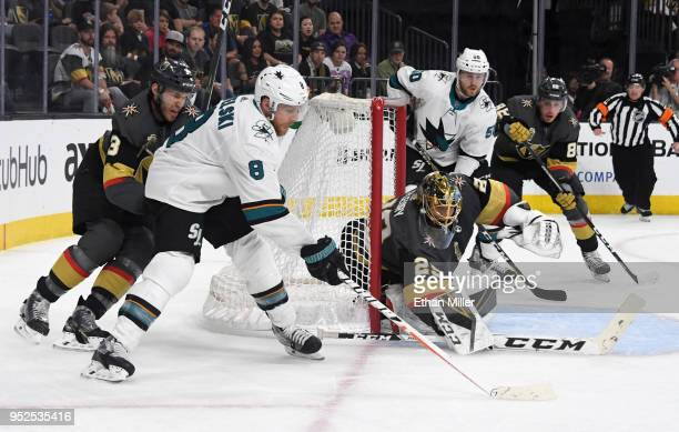 Referees skate over to break up contact between Brenden Dillon of the San Jose Sharks and David Perron of the Vegas Golden Knights in Game Two of the...