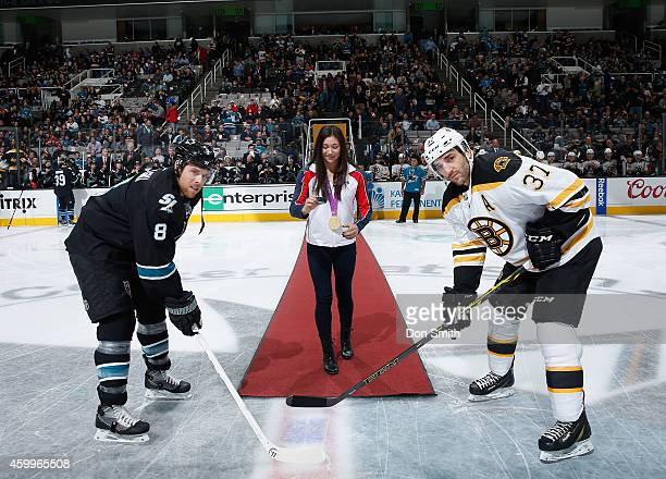 Joe Pavelski of the San Jose Sharks takes the ceremonial face-off against Patrice Bergeron of the Boston Bruins during an NHL game on December 4,...