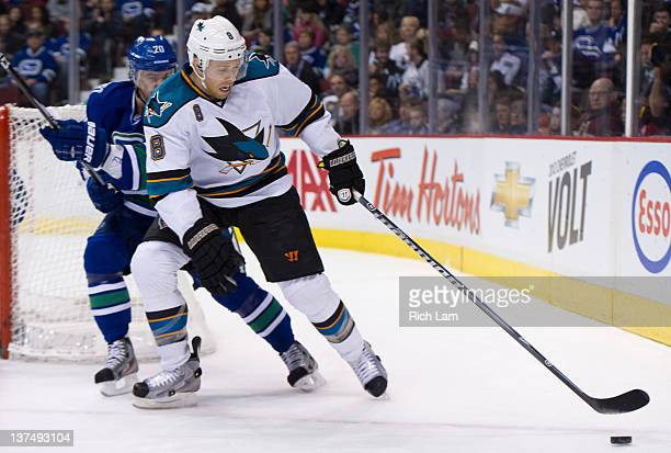 Joe Pavelski of the San Jose Sharks tries to battle through the check of Chris Higgins during the first period in NHL action on January 21, 2012 at...