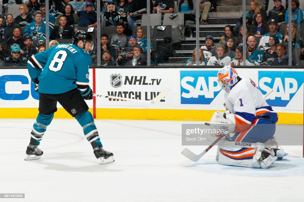 Joe Pavelski #8 of the San Jose Sharks tries to get one by Thomas Greiss #1 of the New York Islanders at SAP Center on October 14, 2017 in San Jose, California.