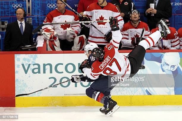 Joe Pavelski of the United States collides with Sidney Crosby of Canada during the ice hockey men's gold medal game between USA and Canada on day 17...