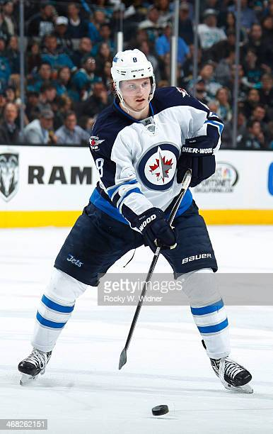 Joe Pavelski of the Winnipeg Jets skates with the puck against the San Jose Sharks at SAP Center on January 23 2014 in San Jose California