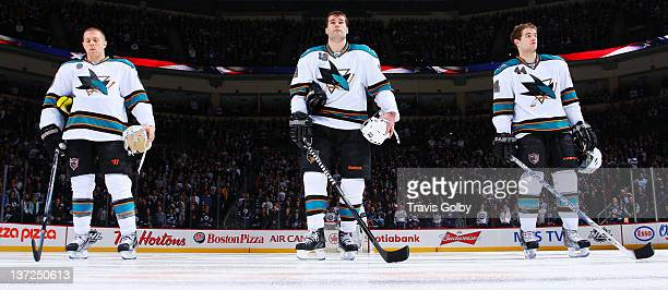 Joe Pavelski Patrick Marleau and MarcEdouard Vlasic of the San Jose Sharks stands on the blueline during the singing of the National anthems prior to...