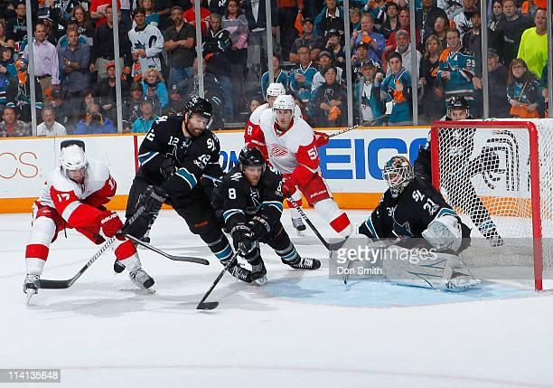 Joe Pavelski, Patrick Marleau, Dan Boyle, and Antti Niemi of the San Jose Sharks defend the net against Valtteri Filppula, Patrick Eaves, and Justin...