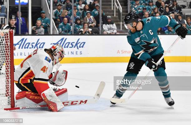 Joe Pavelski shoots the puck on Mike Smith of the Calgary Flames at SAP Center on November 11, 2018 in San Jose, California