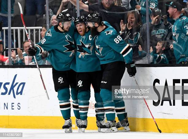 Joe Pavelski Tomas Hertl and Brent Burns of the San Jose Sharks celebrates after Pavelski scored a goal against the Colorado Avalanche during the...