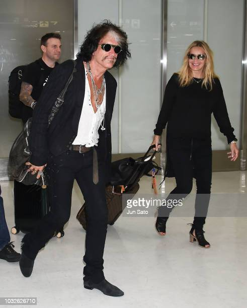 Joe Perry and Billie Paulette Montgomery are seen upon arrival at Narita International Airport on September 13, 2018 in Narita, Japan.
