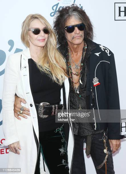Joe Perry and Billie Paulette Montgomery attend Steven Tyler's GRAMMY Awards viewing party benefiting Janie's Fund held at Raleigh Studios on...
