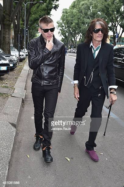 Joe Perry and Roman Perry attend the Emporio Armani show during Milan Menswear Fashion Week Spring Summer 2015 on June 23 2014 in Milan Italy