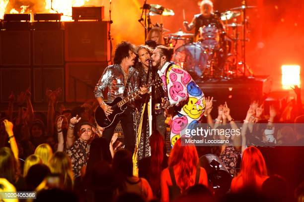 Joe Perry and Steven Tyler of Aerosmith perform with Post Malone onstage during the 2018 MTV Video Music Awards at Radio City Music Hall on August 20...