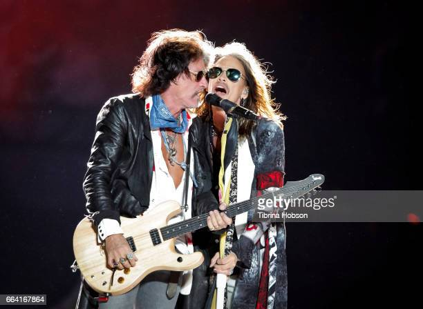 Joe Perry and Steven Tyler of Aerosmith performs at the March Madness Music Festival on April 2 2017 in Margaret T Hance Park in Phoenix Arizona
