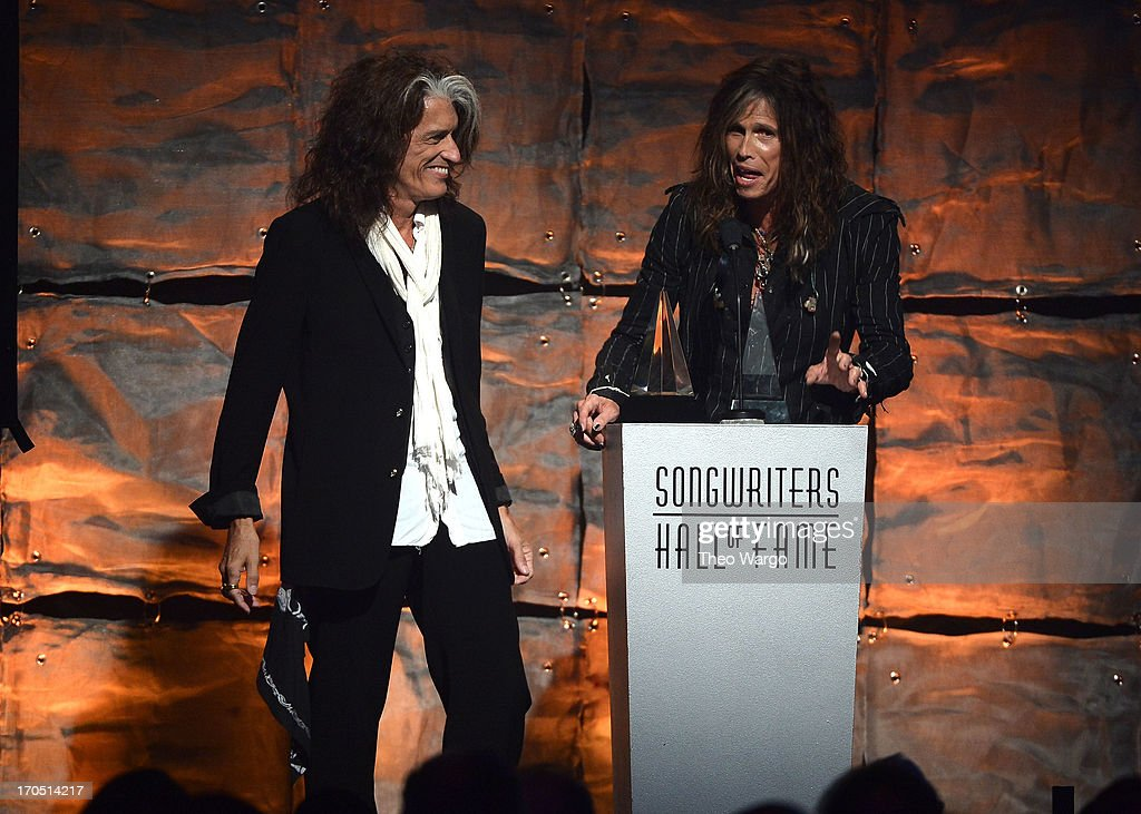 Joe Perry and Steven Tyler of Aerosmith speak at the Songwriters Hall of Fame 44th Annual Induction and Awards Dinner at the New York Marriott Marquis on June 13, 2013 in New York City.