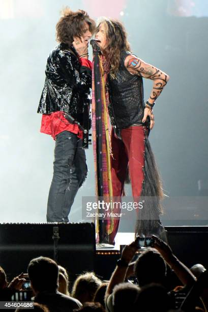 Joe Perry and Steven Tyler perform at Prudential Center on September 3, 2014 in Newark, New Jersey.