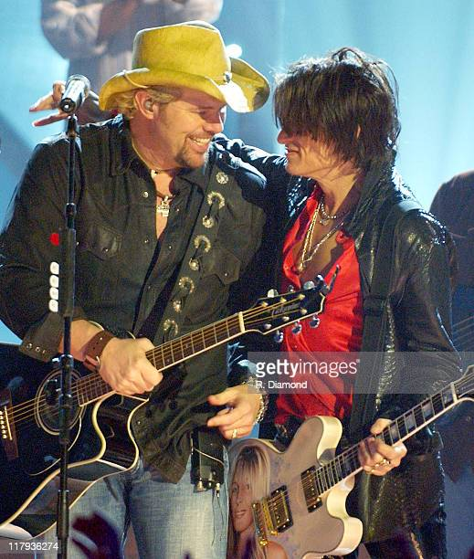 Joe Perry and Toby Keith who hosts the ultimate Super Bowl tailgate party with a live CMT special from Houston on January 31