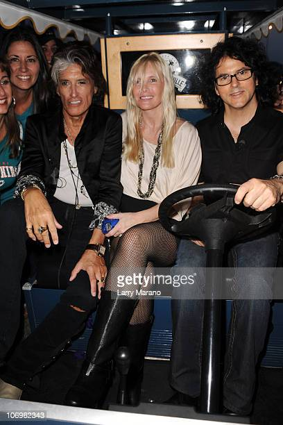 Joe Perry, his wife Billie Paulette Montgomery and Kerry Simon tailgate prior to the Miami Dolphins vs Chicago Bears game at Sun Life Stadium on...