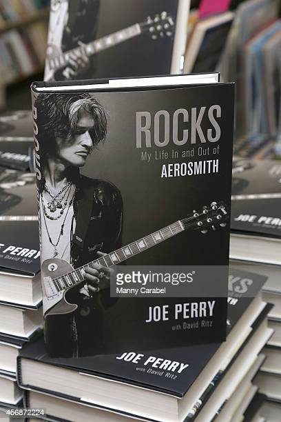 """Joe Perry of Aerosmith signs copies of his new book """"Rocks"""" at Bookends Bookstore on October 8, 2014 in Ridgewood, New Jersey."""