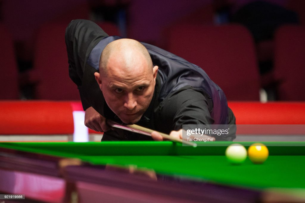 Joe Perry of England plays a shot during his first round match against Graeme Dott of Scotland on day two of 2018 Ladbrokes World Grand Prix at Guild Hall on February 20, 2018 in Preston, England.