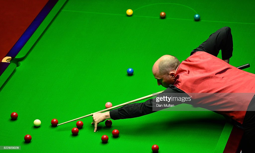 Joe Perry of England plays a shot during his first round match against Kyren Wilson of England on day six of the World Snooker Championship at The Crucible Theatre on April 21, 2016 in Sheffield, England.
