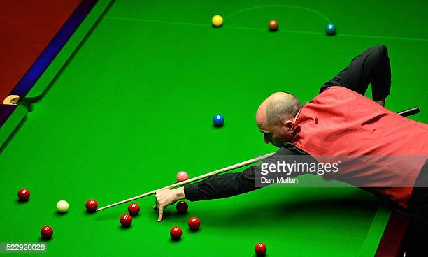 Joe Perry of England plays a shot during his first round match against Kyren Wilson of England on day six of the World Snooker Championship at The...