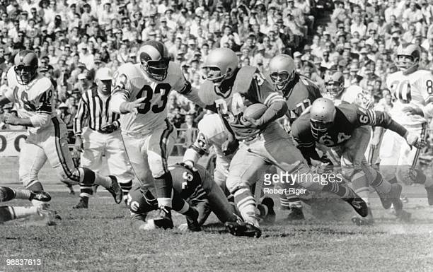 Joe Perry of the San Francisco 49ers carries the ball against Lou Michael of the Los Angeles Rams during the game at Kezar Stadium on October 4, 1959...