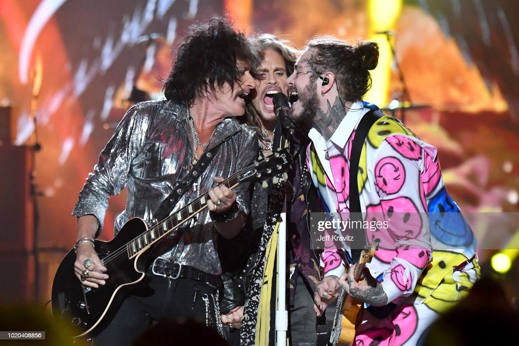 Joe Perry, Steven Tyler, and Post Malone perform onstage during the 2018 MTV Video Music Awards at Radio City Music Hall on August 20, 2018 in New York City.