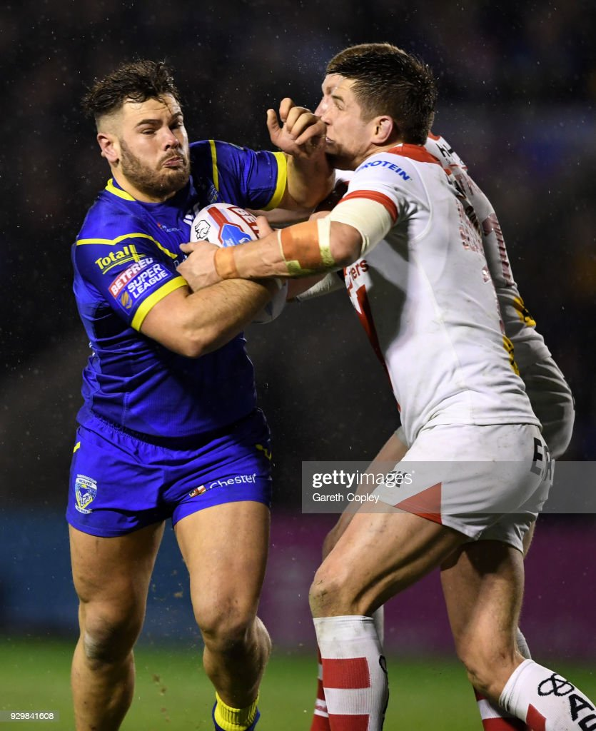 Joe Philbin of Warrington is tackled by Louie McCarthy-Scarsbrook of St Helens during the Betfred Super League between Warrington Wolves and St Helens on March 9, 2018 in Warrington, England.