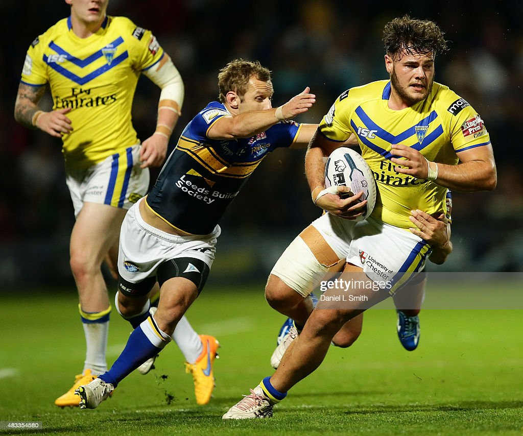 Joe Philbin of Warrington Wolves dodges a tackle from Rob Burrow of Leeds Rhinos during the Round 1 match of the First Utility Super League Super 8s between Leeds Rhinos and Warrington Wolves at Headingley Carnegie Stadium on August 7, 2015 in Leeds, England.