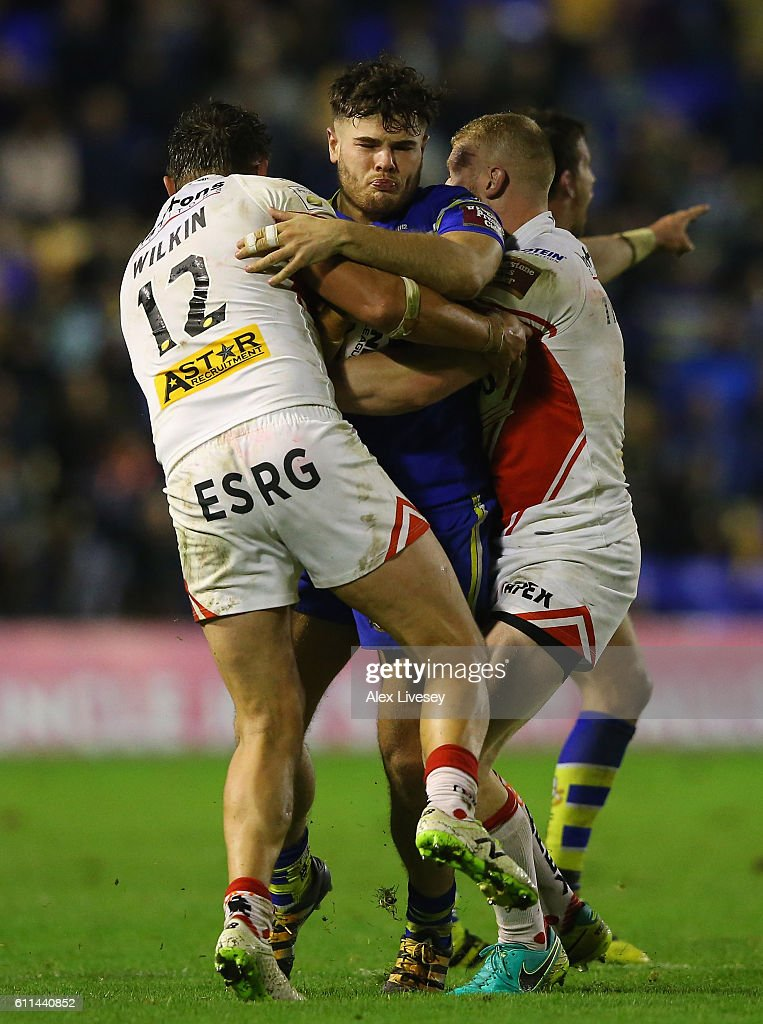 Joe Philbin of Warrington Wolves is tackled by Jon Wilkin of St Helens during the First Utility Super League Semi Final match between Warrington Wolves and St Helens at The Halliwell Jones Stadium on September 29, 2016 in Warrington, England.