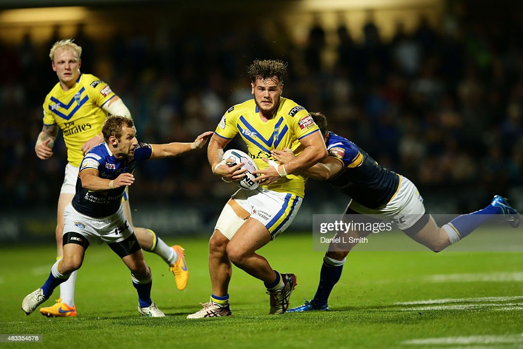 Joe Philbin of Warrington Wolves is tackled by Mitch Garbutt of Leeds Rhinos during the Round 1 match of the First Utility Super League Super 8s between Leeds Rhinos and Warrington Wolves at Headingley Carnegie Stadium on August 7, 2015 in Leeds, England.