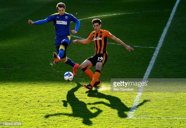 Joe Pigott of AFC Wimbledon battles for possession with Jacob Greaves of Hull City during the Sky Bet League One match between AFC Wimbledon and Hull...