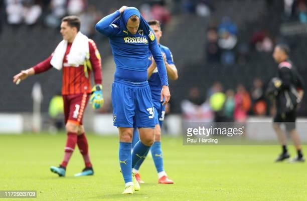 Joe Pigott of AFC Wimbledon looks dejected after the Sky Bet League One match between Milton Keynes Dons and AFC Wimbledon at Stadium mk on September...