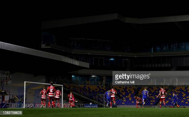 Joe Pigott of AFC Wimbledon scores his sides second goal during the Sky Bet League One match between AFC Wimbledon and Doncaster Rovers at Plough...