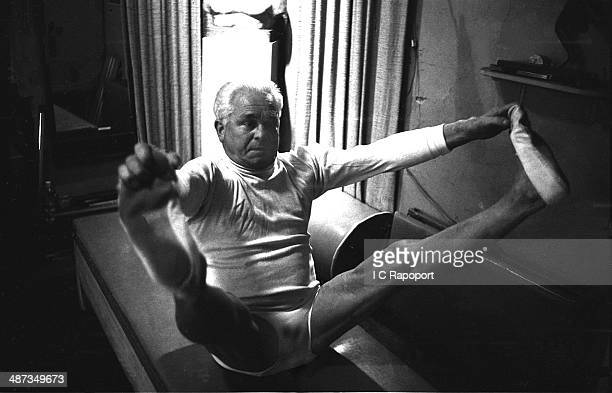 Joe Pilates Inventor physical fitness guru and founder of the Pilates exercise method demonstrates his techniques in his 8th Avenue studio on October...