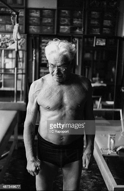 Joe Pilates Inventor physical fitness guru and founder of the Pilates exercise method takes a break from his routine in his 8th Avenue studio on...