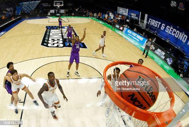 Joe Pleasant of the Abilene Christian Wildcats sinks the game-winning free throw against the Texas Longhorns to win 53-52 in the first round game of...