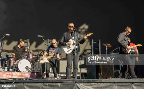 Joe Plummer Matt Maust Nathan Willett and David Quon of Cold War Kids perform during Voodoo Music Arts Experience at City Park on October 29 2017 in...